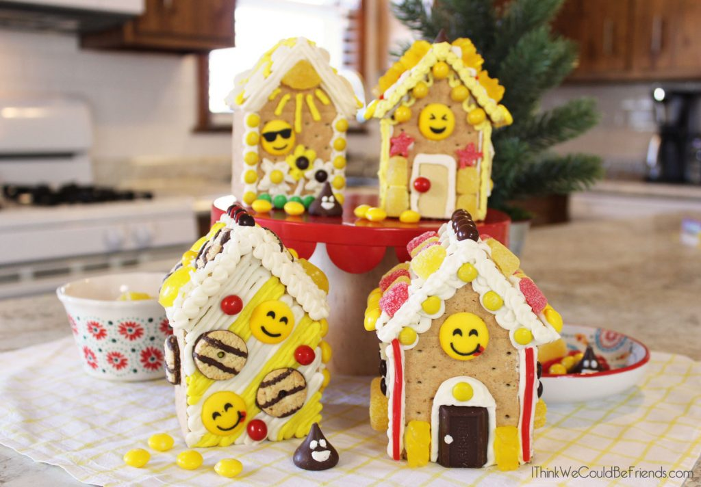 This is a SUPER FUN twist on Christmas Gingerbread Houses! Perfect for older kids, includes directions to make the graham cracker gingerbread houses, plus decorations & ideas! #Emoji #Birthday #Party #Ideas #Decorations #Gingerbread #Houses #Easy #DIY
