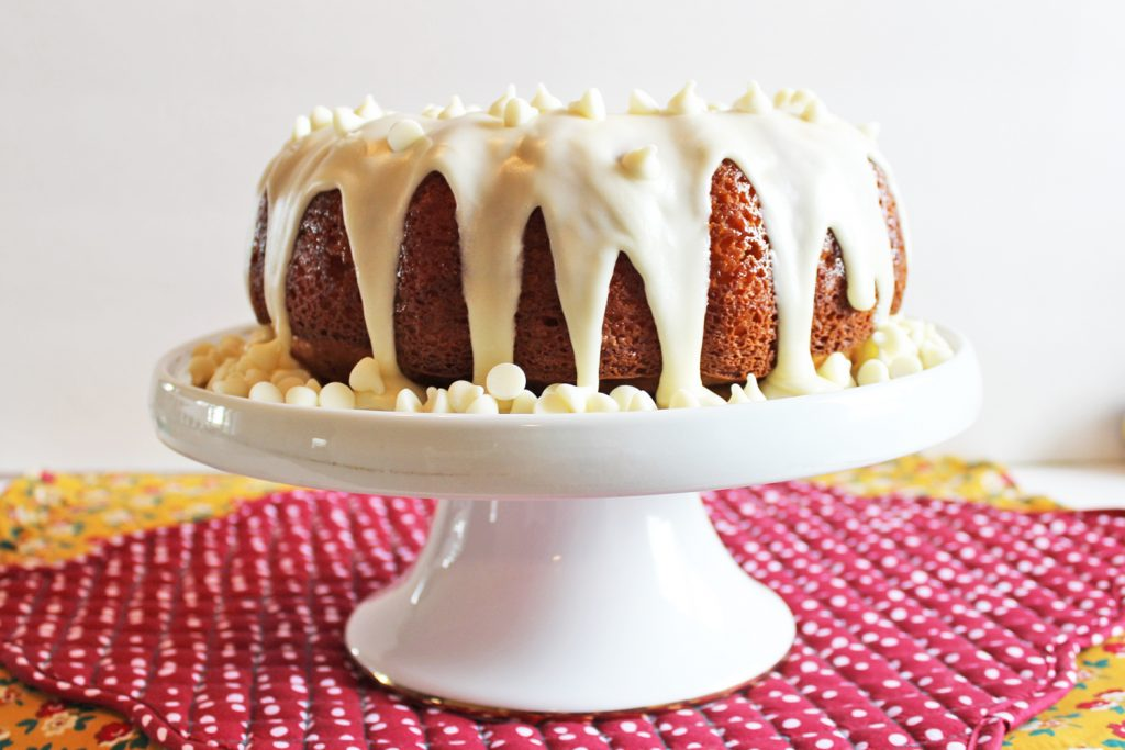 Incredibly RICH and MOIST White Chocolate Vanilla Bundt Cake! Oh, and its EASY, too! It starts with a boxed cake mix and then you add sour cream AND pudding--SO GOOD!!!! #bundt #cake #recipe #white #chocolate #vanilla