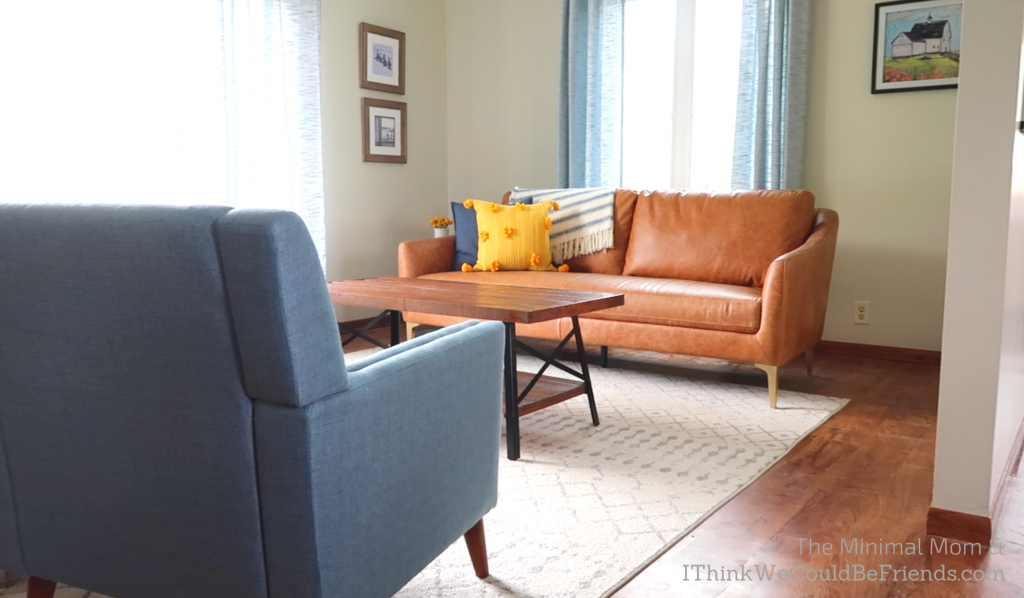 minimalist living room, brown couch, blue chair