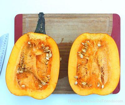 pumpkin cut in half with seeds